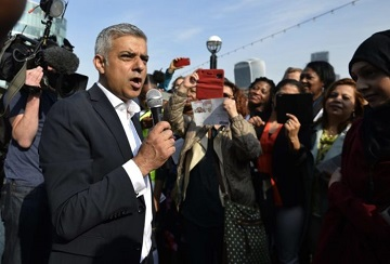 Britain's newly elected mayor Sadiq Khan speaks to supporters as he arrives for his first day at work at City Hall in London, Britain May 9, 2016. REUTERS/Hannah McKay/File Photo