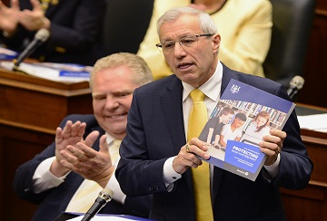 Ontario Finance Minister Vic Fedeli presents the 2019 budget as Premier Doug Ford looks on at the legislature in Toronto on Thursday, April 11, 2019. THE CANADIAN PRESS/Frank Gunn
