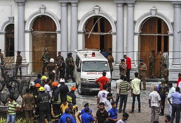 Sri Lankan Army soldiers secure the area around St. Anthony Shrine after a blast in Colombo, Sri Lanka, Sunday, April 21, 2019. More than hundred were killed and hundreds more hospitalized with injuries from eight blasts that rocked churches and hotels in and just outside of Sri Lanka's capital on Easter Sunday, officials said, the worst violence to hit the South Asian country since its civil war ended a decade ago. (AP Photo/Chamila Karunarathne)