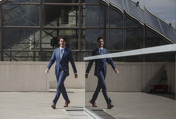 Prime Minister Justin Trudeau walks to a press conference during a visit to Edmonton on Friday, May 10, 2019. THE CANADIAN PRESS/Jason Franson