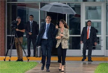Canadian Prime Minister Justin Trudeau and his wife Sophie Gregoire Trudeau board the government plane as they depart for the G20 in Japan, on Wednesday June 26, 2019 in Ottawa. THE CANADIAN PRESS/Adrian Wyld