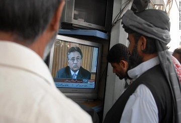 Pakistani men watch the television broadcast of Pakistani President Pervez Musharraf addressing the nation at a shop in Quetta on August 18, 2008.  Musharraf resigned on 18 August, bringing down the curtain on a turbulent nine years in power to avoid the first impeachment in the nuclear-armed nation's history. The key US ally, who seized power in a 1999 coup, announced the move in a lengthy televised address, rejecting the charges against him but saying he wanted to spare Pakistan a damaging battle with the ruling coalition.  AFP PHOTO/Banaras KHAN (Photo credit should read BANARAS KHAN/AFP/Getty Images)