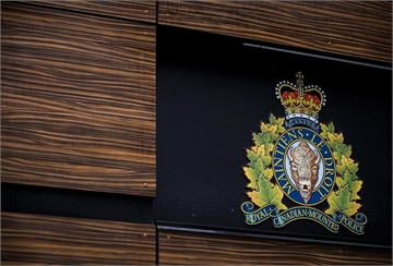 "The RCMP logo is seen outside Royal Canadian Mounted Police ""E"" Division Headquarters, in Surrey, B.C., on April 13, 2018. A bail hearing is underway for Cameron Jay Ortis, a senior RCMP official accused of breaching official-secrets law. Ortis, 47, faces charges of violating the Security of Information Act and breach of trust for allegedly trying to disclose classified information to an unspecified foreign entity or terrorist group. THE CANADIAN PRESS/Darryl Dyck"