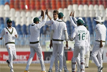 Pakistan pacer Shaheen Shah Afridi, center, celebrates with teammates after taking the wicket of Bangladesh Mominul Haque during the fourth day of their 1st test cricket match against Bangladesh at Rawalpindi cricket stadium in Rawalpindi, Pakistan, Monday, Feb. 10, 2020. (AP Photo/Anjum Naveed)