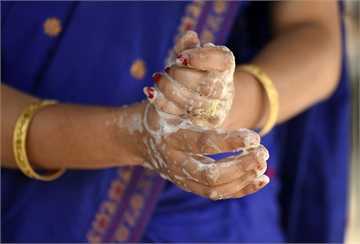 A woman washing her hands as she is protecting herself from Coronavirus, in a village at Barpeta district of Assam in India on Friday, 20 March 2020.  (Photo by David Talukdar/NurPhoto)