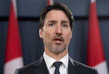 Prime Minister Justin Trudeau speaks during a news conference on the coronavirus situation, in Ottawa, Wednesday, March 11, 2020. THE CANADIAN PRESS/Adrian Wyld