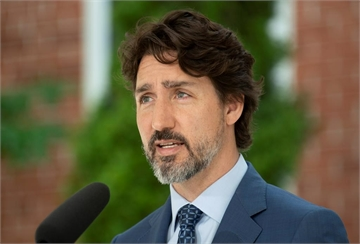 Prime Minister Justin Trudeau delivers his opening remarks during a news conference outside Rideau Cottage in Ottawa, Monday June 22, 2020. THE CANADIAN PRESS/Adrian Wyld