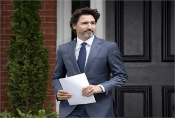 Prime Minister Justin Trudeau makes his way to the podium for a news conference outside Rideau Cottage in Ottawa, Thursday, June 25, 2020. THE CANADIAN PRESS/Adrian Wyld